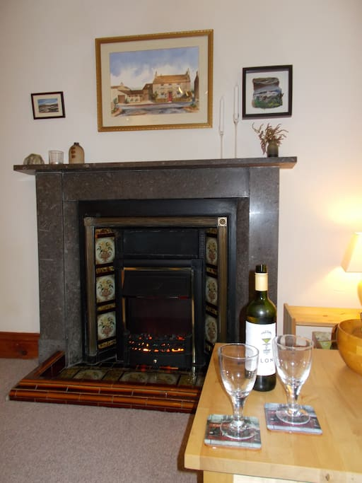 Original Dent marble fireplace with flame effect electric fire, for cosy evenings in.