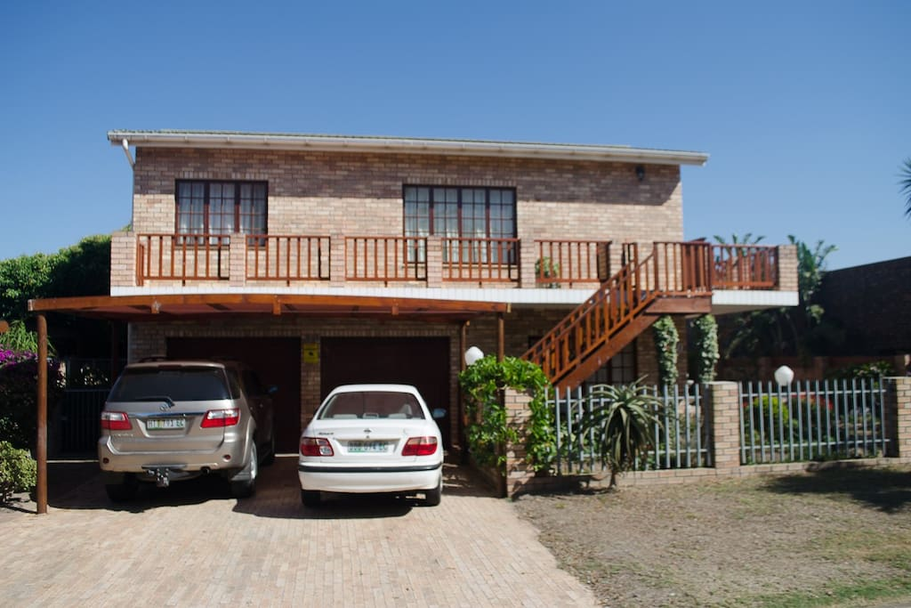 Private access via staircase and balcony. Shaded parking. Walk across the road and you are on the Kabeljouws Beach.