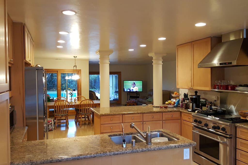Large fully equipped kitchen with great room and dining area with seating for 8