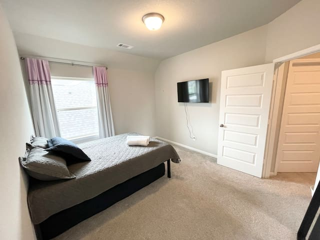 Bedroom with full sized bed & twin trundle.
