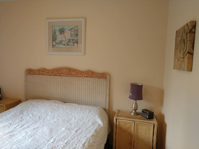 Quaint room with comfy double bed.