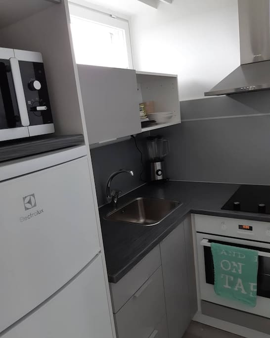 the kitchen is very small, but it is modern and just renovated.
