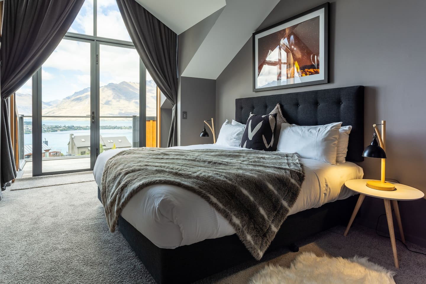 Oversize master bedroom on ground floor with combustion fireplace, balcony and ensuite