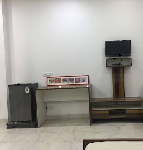 Tv, Work Station & Fridge