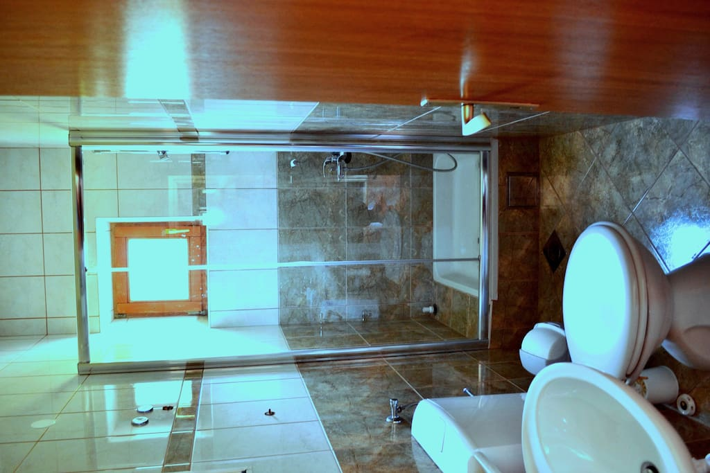 Fully equiped toalet with glass cabin shower in each room