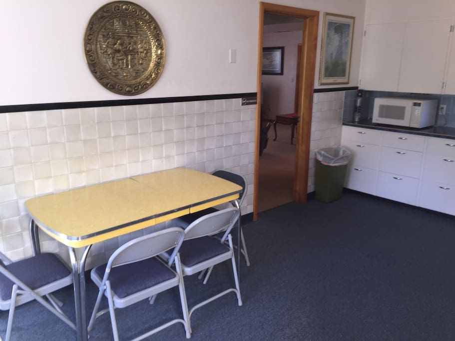 Eating Area in Kitchen.  Microwave.