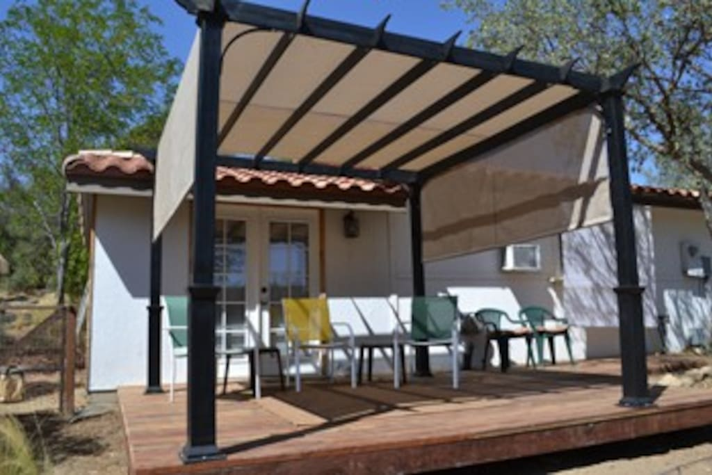 Brand new covered deck on the back of the Casita with great view of the meadow, horses, and forest. Wonderful place to chill out!