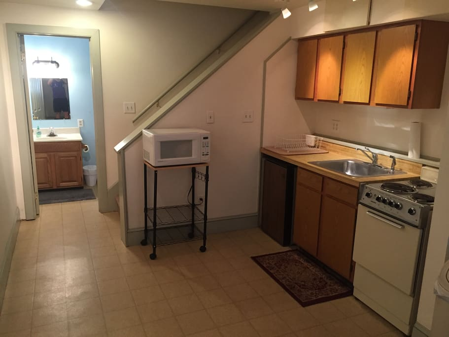 Kitchenette (with microwave, stove, sink, and small refrigerator)