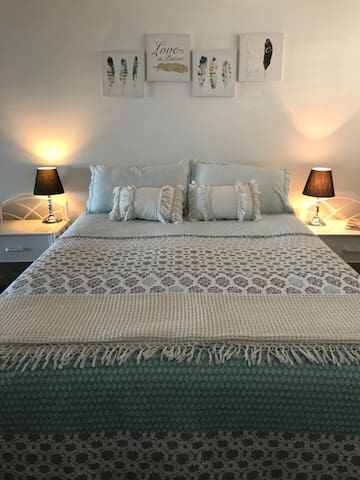 Your queen bed with electric blanket and bedside tables for a good night's sleep