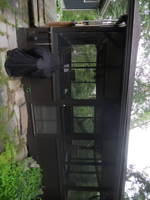 Screened porch with charcoal grill