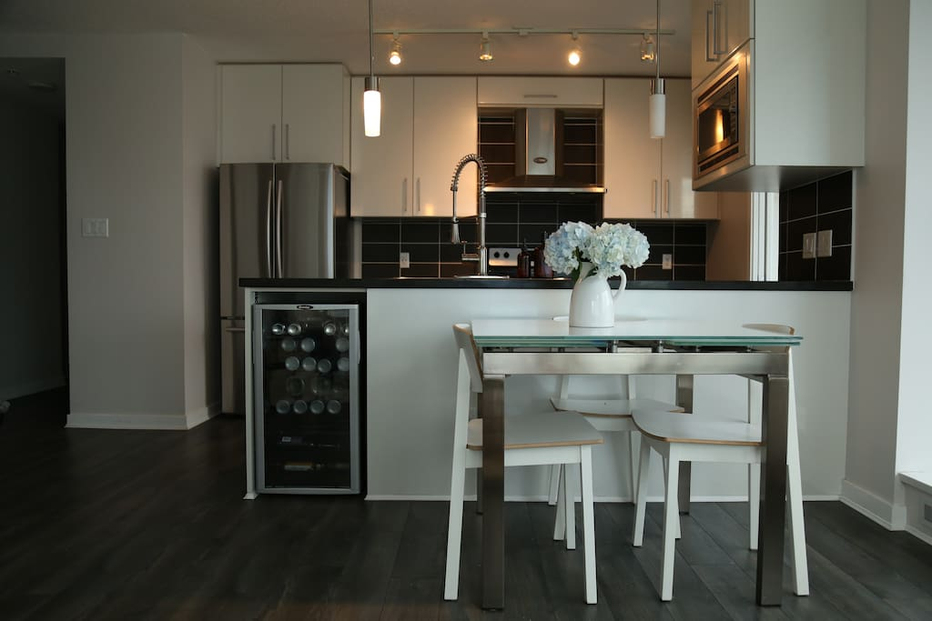 Fully equipped kitchen with open plan so you can fully engage with friends in the living room
