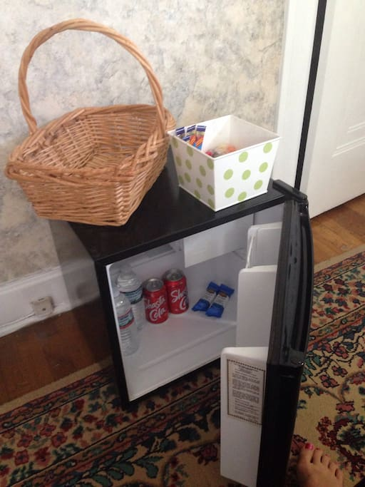 Guests get their own mini fridge with snacks and drinks
