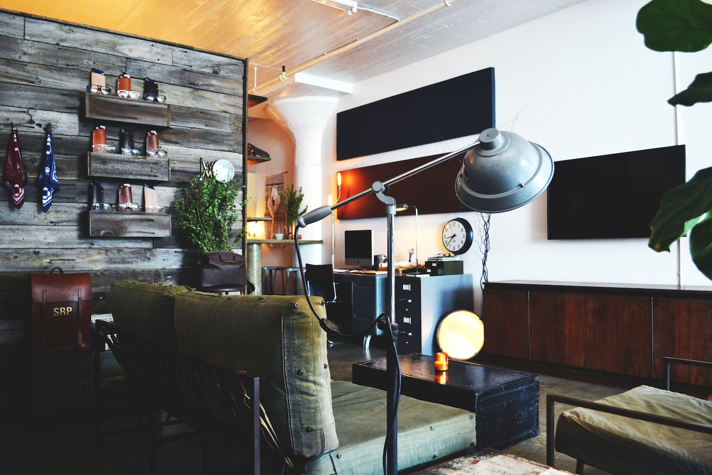 Living room complete with hand-built barn wood wall, one of a kind designer furniture/vintage pieces, and modern walnut credenza | Our loft includes high speed wifi  | Hulu Plus | Netflix | Amazon Instant Prime