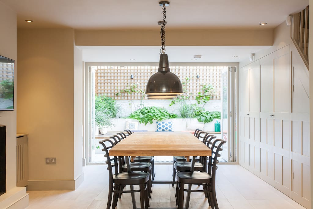 Dining room with bi-folding doors leading to garden