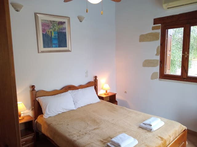 Main Bedroom. High beamed ceiling with fan. Air-conditioning to provide cooling and heating. A safe is provided here