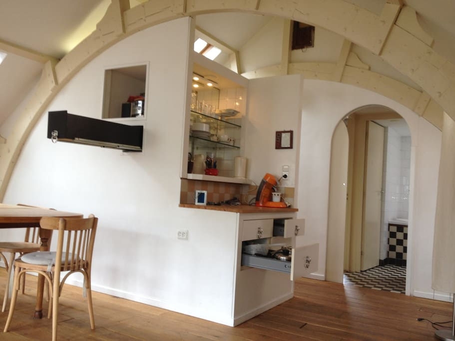 view into the kitchen, with bathroom in background
