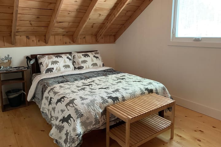 Bedroom #1 is the mirror image of bedroom #2 and is located on the top floor overlooking the surrounding forest.