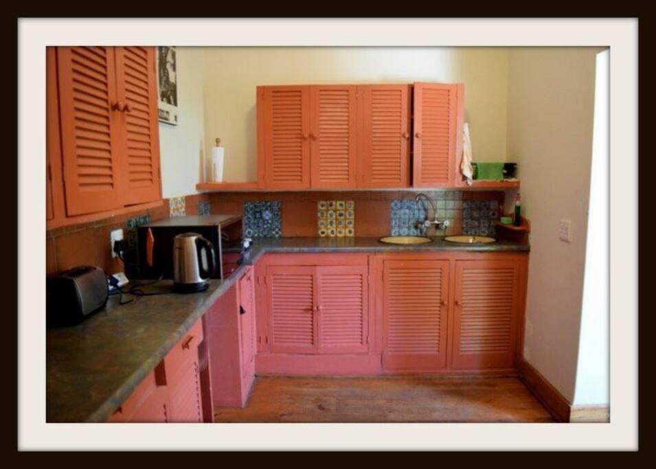 Open plan kitchen with Oregon pine wood floors.