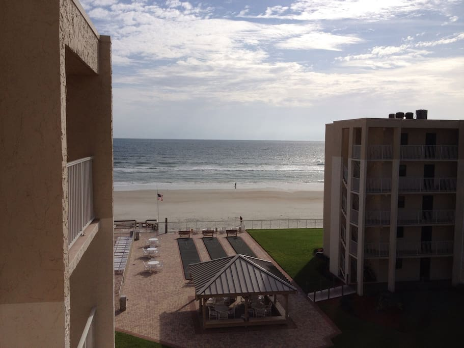View from private balcony overlooking shuffleboard courts and ocean