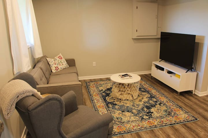 "The sitting room has a comfy couch, a sitting chair and a 55"" TV with Netflix!"