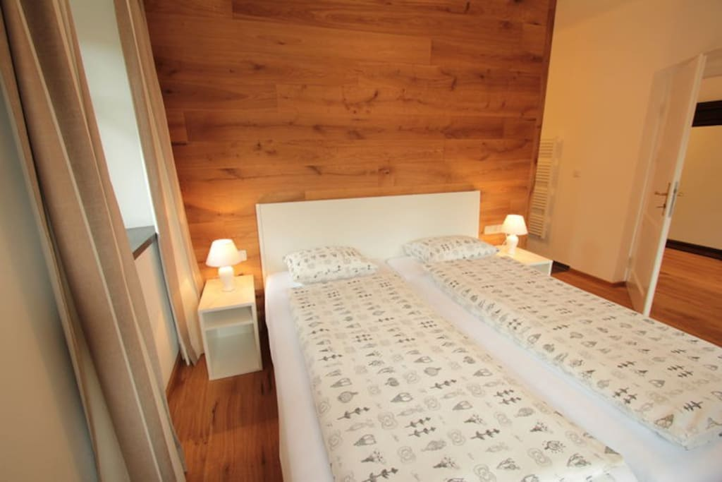 Cosy bedroom with wooden floor and ensuite bathroom