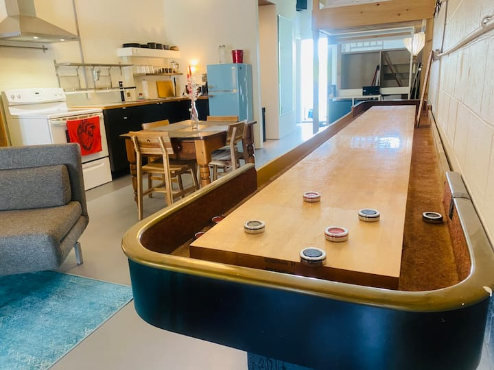 Spacious loft with shuffleboard table
