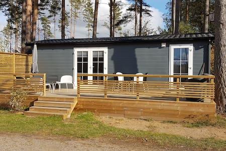 Modern tiny house - 100 m to the lake!