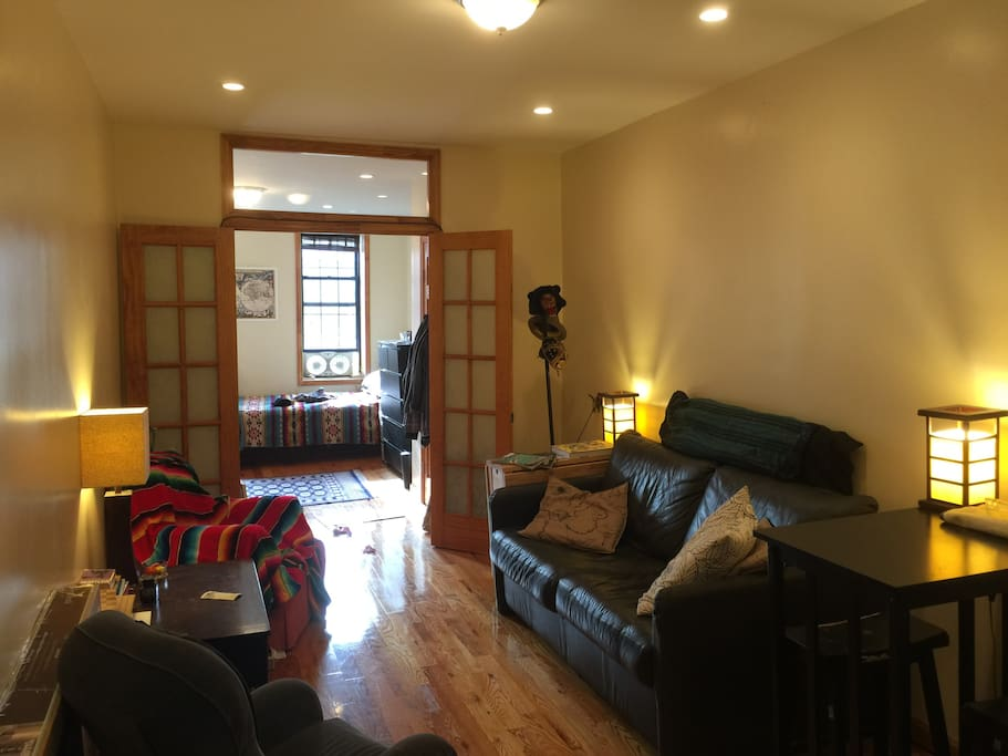 Here is the living room facing the front room - (pictured first)...  The black leather couch CAN fold out into a bed, for an Extra guest.  (Upon request if needed, as another option).