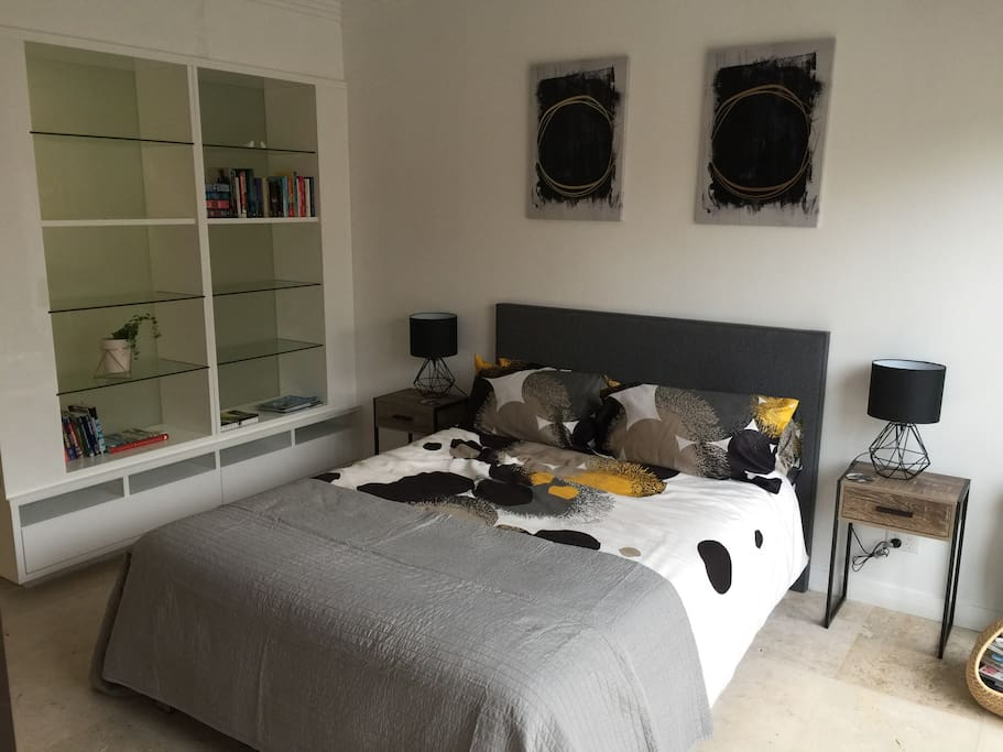 Double bed and ample storage for your stay. Dyson cool and hot air system, iron, all bedding provided. Opens to patio garden area. Through to ensuite bathroom.