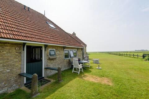 Appartement in woonboerderij met 2 km  uitzicht