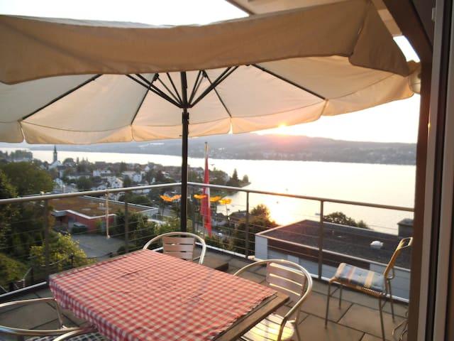 Balcony with giant umbrella.