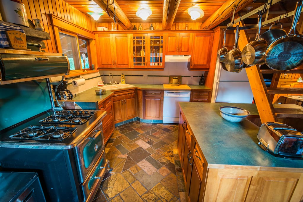 Kitchen fully equipped: dishwasher, microwave, coffee maker, blender & toaster. Using a blend of beautiful cherry, cedar and pine wood, this highly modern country kitchen is for the serious holiday chef.  New Heartland propane stove. Washer & Dryer; Central Vacuum - you're on vacation!