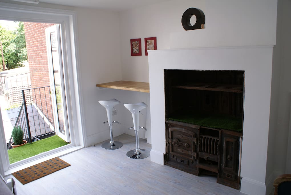 Entrance and 1895 Victorian stove in kitchen and breakfast bar.