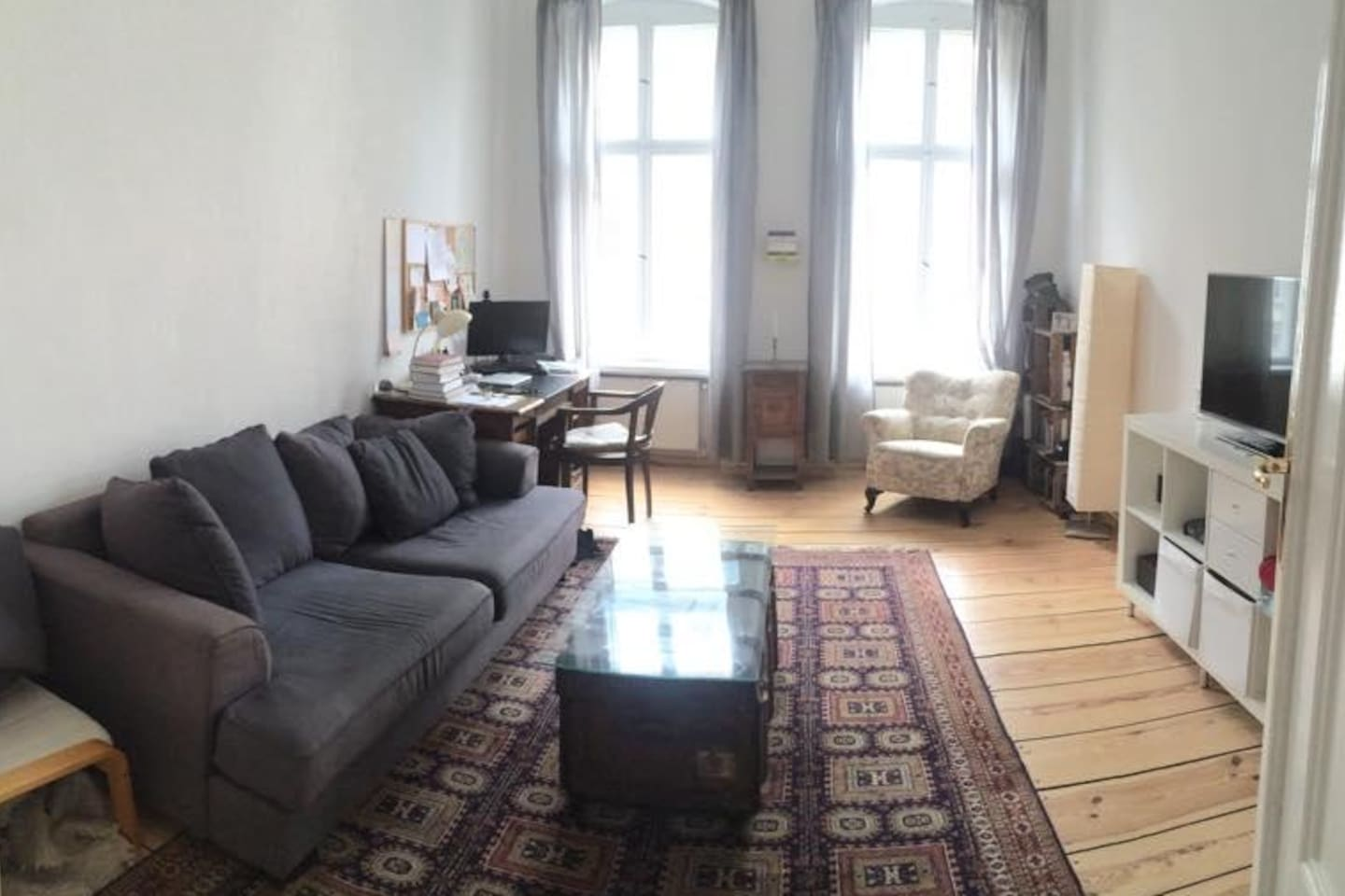 big, bright room with a comfy couch and a 3D television