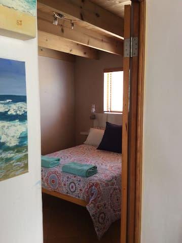 Bedroom and en suit shower room with double bed: