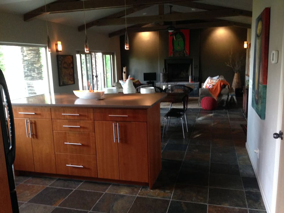 Sun-filled open floor plan. Kitchen, dining and living areas with cathedral ceiling