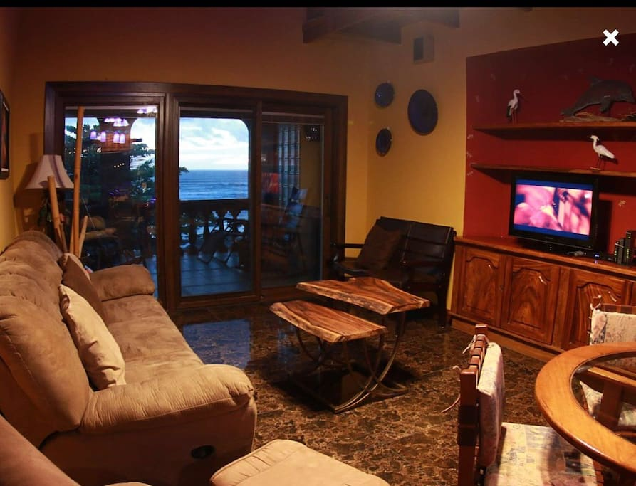 Living room with ocean sunset view