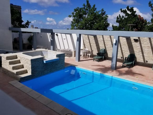 Independent suite, in luxurious villa with pool.