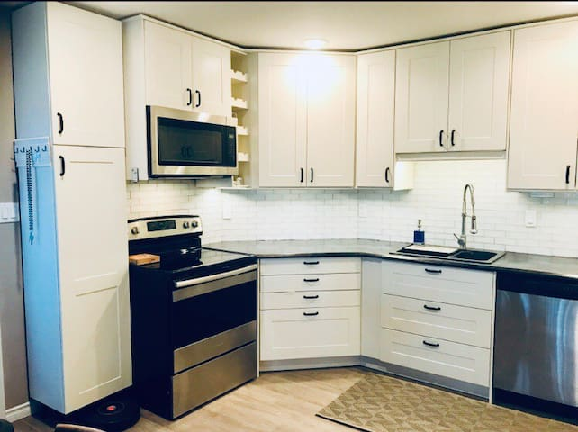 Large bright kitchen with new appliances