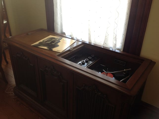 Console stereo with record player and fm/am radio.