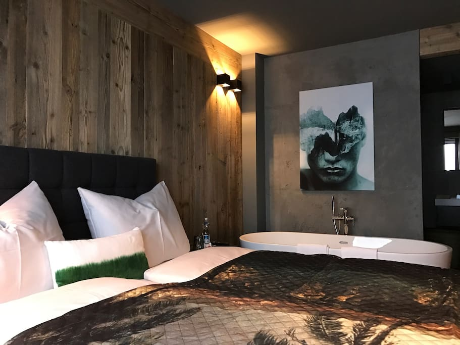 The Master Bedroom -  box-spring bed  1,80 x 2,00 m     - big chair - 50 inch tv -  wood floor - cabinet  -  old wood