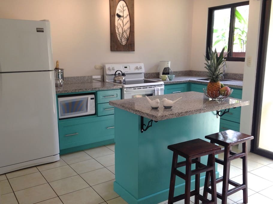 Granite island with seating for 2.