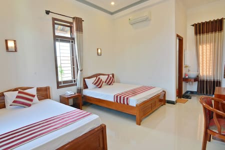 DELUXE TRIPLE ROOM WITH GARDEN VIEW - Hội An
