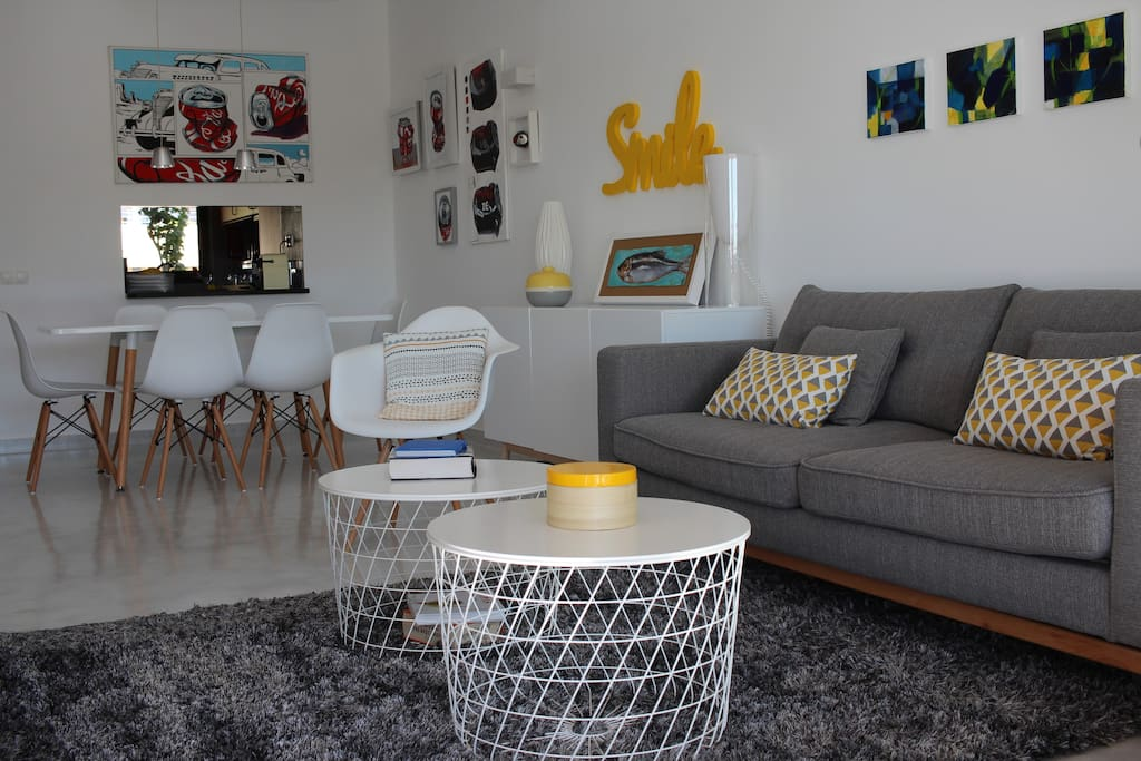 Living Room and Dining Room areas. Plenty of original art throughout the apartment