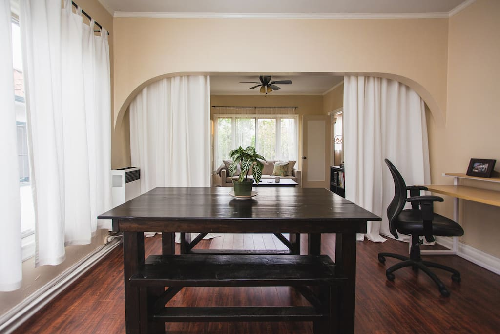 Dining room features a big farmhouse table for family dinners or open office space