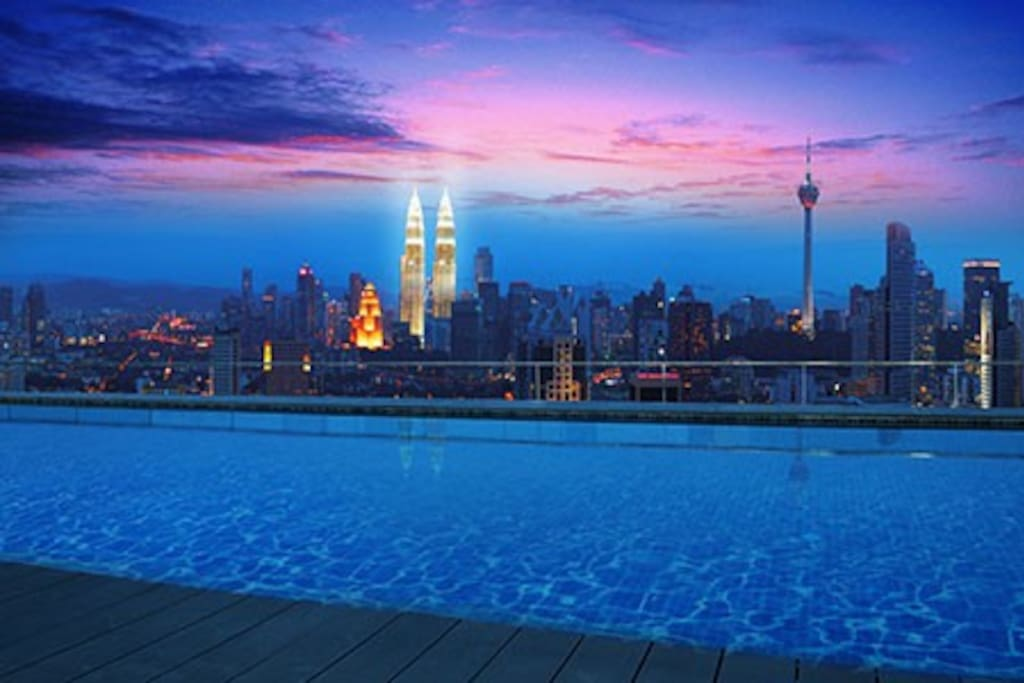 Rooftop infinity pool  view at night