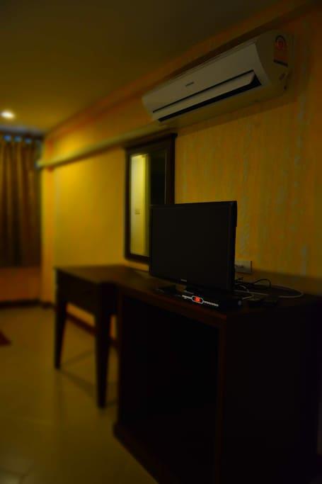 LCD TV, fridge, hardwood furniture