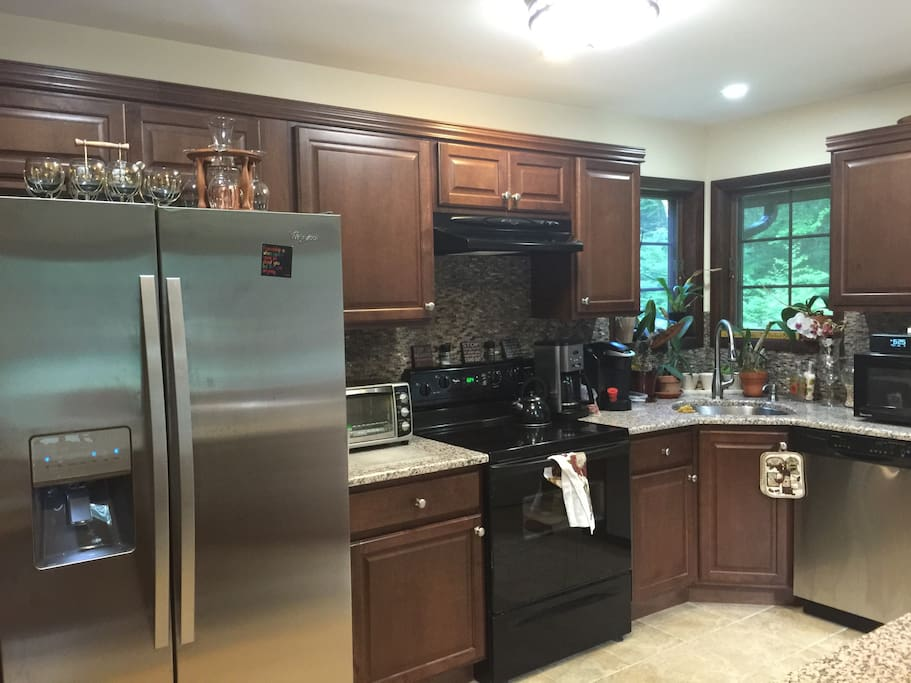 Modern kitchen with new appliances, granite countertops, stainless steel appliances for your cooking ease
