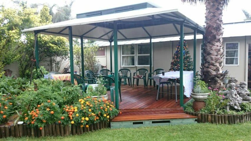 Beautiful private deck next to cottage with braai facilities. A lovely sunny spot in wintertime.