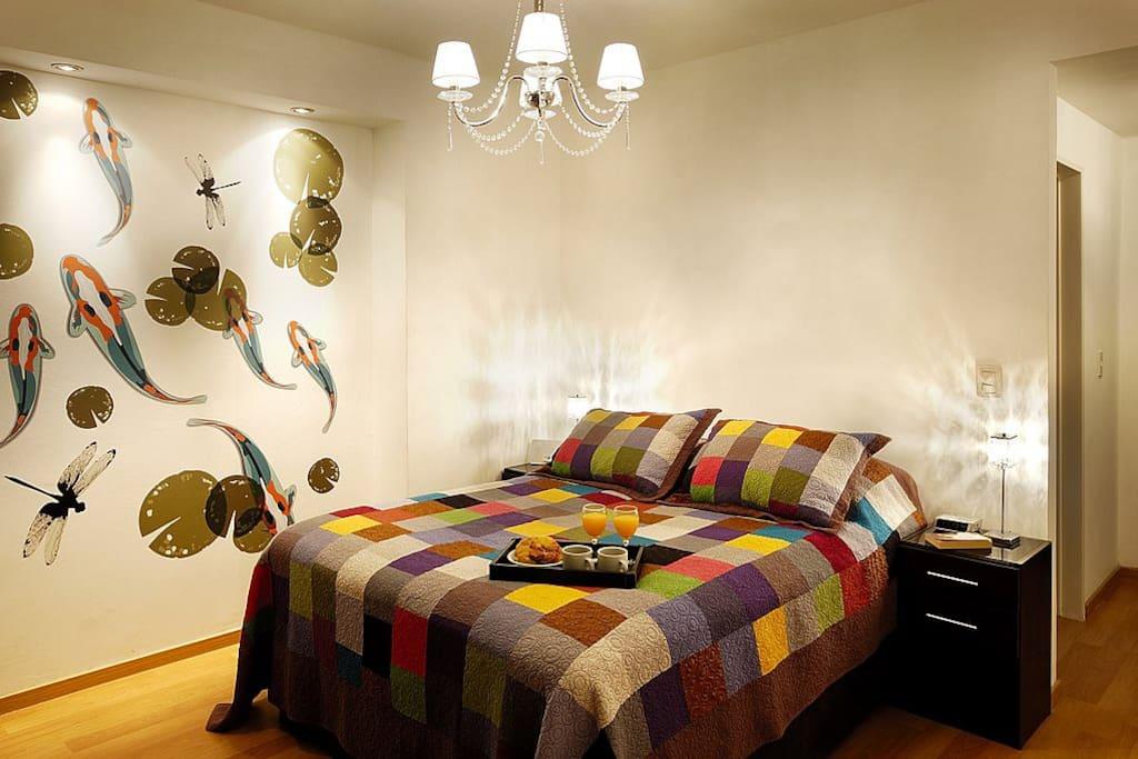 The open bedroom features a super-comfy La Cardeusse mattress.